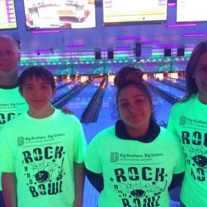 Two Bigs and two Littles pose at Bowl For Kids Sake event